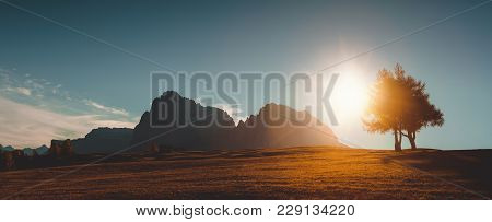 Autumn Sunrise Scenery With Small Alpine Building And Odle - Geisler Mountain Group On Background. A