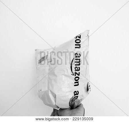 Paris, France - Feb 21, 2018: Man Holding Against White Background Plastick Amazon Prime Parcel Bag