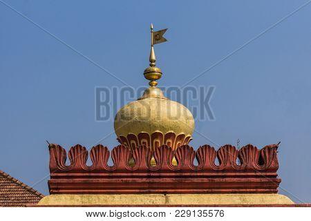 Madikeri, India - October 31, 2013: Shree Omkareshwara Temple. Top Gold-yellow Dome With Metal Flag