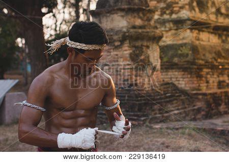 Ancient Muay Thai, Asian Man Exercising Thai Boxing,ancient Traditional Muay Thai Or Thai Boxing Fig