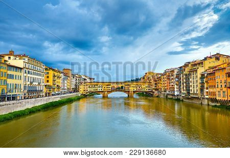 Panorama view to ancient bridge Ponte Vecchio at river Arno in Florence old town, famous touristic place of Tuscany region, Italy.