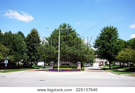 Joliet, Illinois / United States - July 30, 2017: A Magnificent Flower Garden Blooms At The Entrance