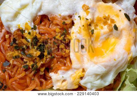 Close Up Photo Of Cooked Spicy Sauce Instant Noodle Topping With Fried Egg. The Easy Homemade Dish C
