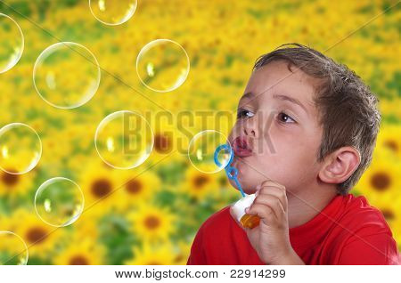 Adorable Child Blowing Soap Bubbles