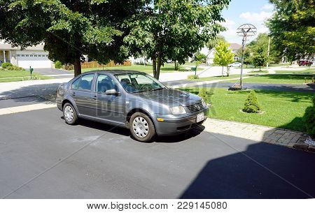 Joliet, Illinois / United States - July 30, 2017: A Volkswagen Jetta Is Parked In The Driveway Of A