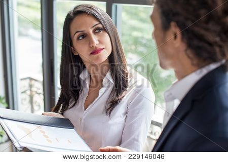 Happy Multiethnic Man Concluding Deal With Female Business Partner. New Partnership Concept. Pensive