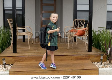 6 Or 7 Years Old Female Child Smiling Happy Smiling Cheerful Carrying Big Heavy  School Backpack Wea