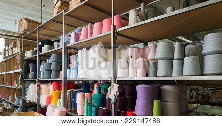 Color Thread Spools Kept On Shelves At Knitting Factory Shot