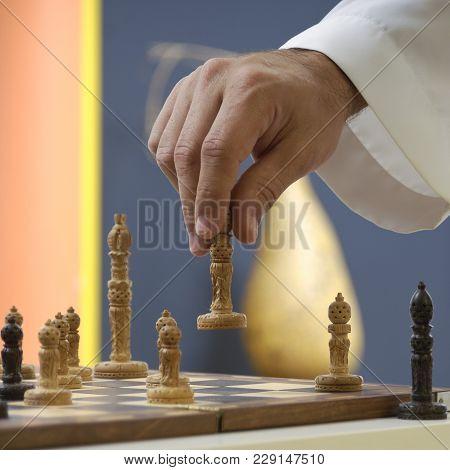 Arab Man Hand Playing Chess At Home