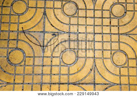 Purple And Yellow Patterned Paving Tiles On The Street, Top View. Cement Bricks, Squared Stone Groun