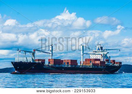Container Vessel Underway On Puget Sound, Washington.