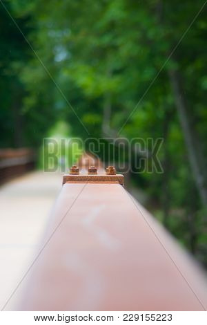 Joint In Bridge Railing During Light Rainfall.