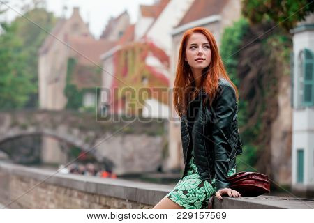 Young Redhead Girl Rest On The Street In Brugge