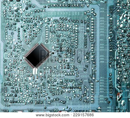 Photo Of Cool Small Modern Microchip On Circuit Plate