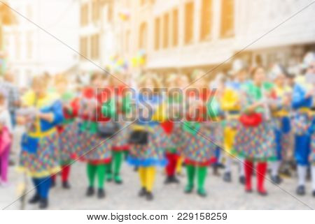 Abstract Blurry Background Of Carnival Parade Of The World, Traditional Festival Present With Man An
