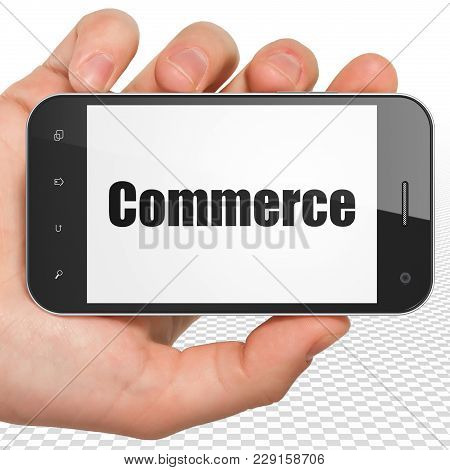 Business Concept: Hand Holding Smartphone With Black Text Commerce On Display, 3d Rendering
