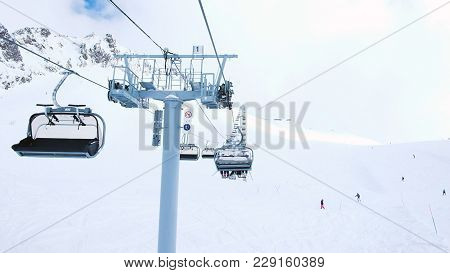 View From The Open Lift In Motion Upstairs, Four-seat Lifts Work At The Ski Resort, Downhill Skiing
