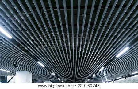 Lights And Ventilation System In Long Line On Ceiling Of The Dark Office Industrial Building Exhibit