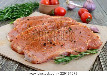 Fresh And Raw Meat. Sirloin Steaks In A Row Ready To Cook. Large Pieces Of Raw Meat In Marinade With