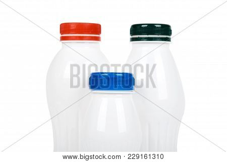 Three White Plastic Bottles With Drink Yogurt Or Milk. Isolated On White Background. Container Merch