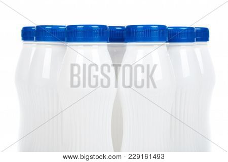 Group Of White Plastic Bottles With Drink Yogurt Or Milk. Isolated On White Background. Container Me