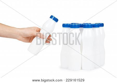 White Plastic Bottle With Drink Yogurt Or Milk With Hand. Isolated On White Background. Container Me