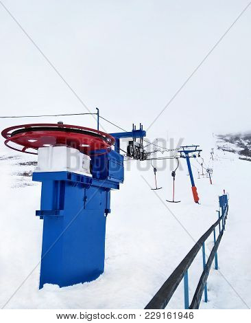 Ski Lift At Snowy Winter Day In Mountain Ski Resort
