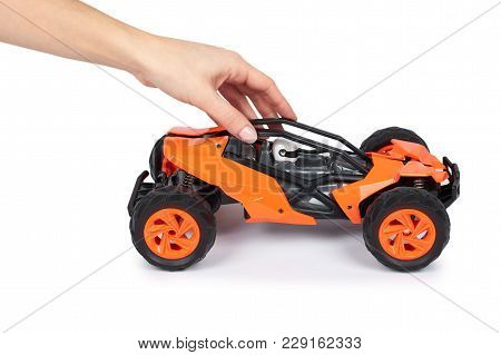 Rc Model Rally, Off Road Buggy In Hand. Isolated On White Background, Joy And Fun Sport.