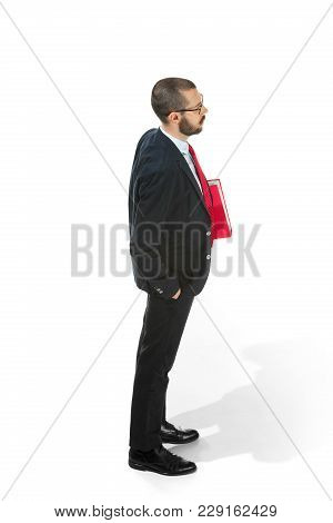 Full Body Or Full-length Profile Of Businessman With Red Folder On White Studio Background. Serious