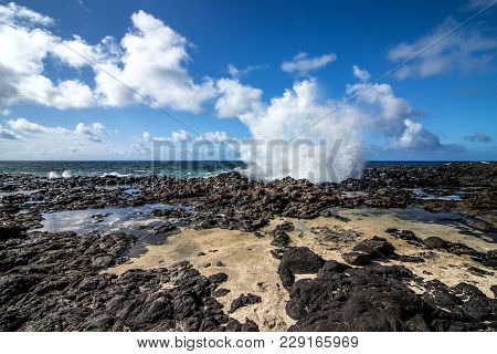 The Splash Of The Water In The Stone Shore Of Kauai