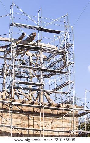 The Old Bell Tower. Restoration Of The Old Bell Tower. Scaffolding. Old Bell