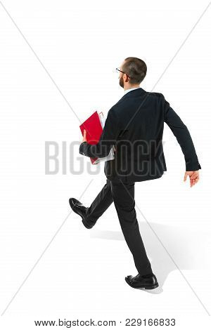 Full Body Rear Or Back View Of Businessman Going With Red Folder On White Studio Background. Serious