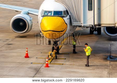 The Airplane Engineer Of Nok Air Flight Is Checking The Plane Before Leaving, Aircraft Name Is Bomba