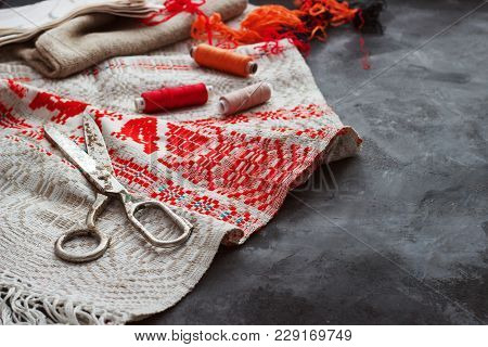 Scissors, Bobbins With Thread And Needles, Striped Fabric. Old Sewing Tools On The Background. Vinta