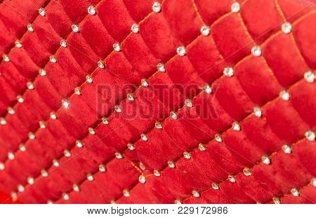 Velvet Red Upholstery With Rhinestones As Background.