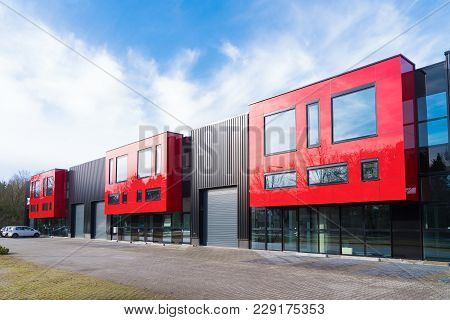 Denekamp, Netherlands - February 4, 2017: Modern Exterior Of A Newly Build Industrial Building With