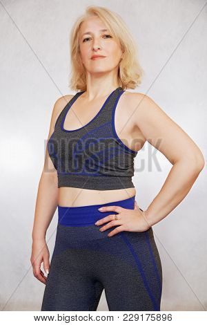 A Confident Woman At The Age Of 48 Demonstrates A Beautiful Physique. Positive Result From Playing S
