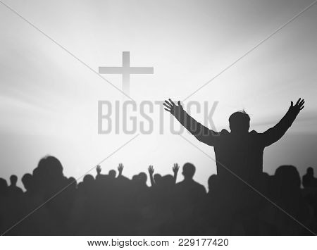 Silhouette People Raising Hands Over Blurred The Cross On Beautiful Golden Autumn Sky Sunset Backgro