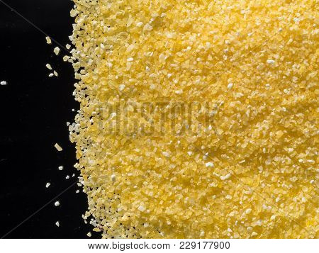 Raw Dry Grains Polenta On Black Background, Close-up, Top View
