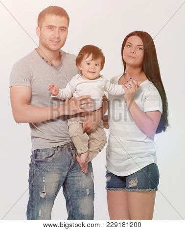 Parents with son studio shot