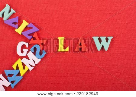 Word On Red Background Composed From Colorful Abc Alphabet Block Wooden Letters, Copy Space For Ad T