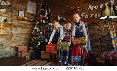 The Three Brothers Rejoice At Gifts Received On Holidays And Try To Guess What Inside Boxes. Blonde