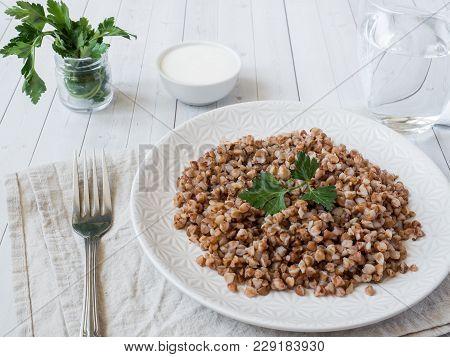 Buckwheat Porridge With Parsley Leaves In A Plate, Healthy Food