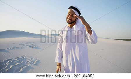 Close-up Shot Of Portrait Of Arabian Sheikh Young Man With Beautiful Smile That Looks At Camera And