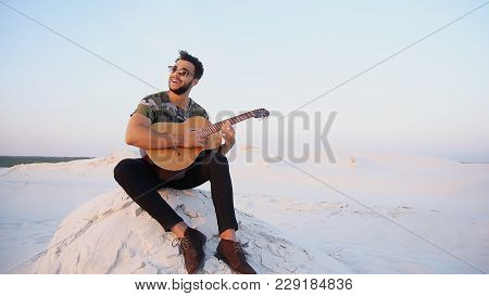 Ambitious Budding Musician, Muslim Guy Performs Lyrical Melody On Musical Instrument And Guitar, And