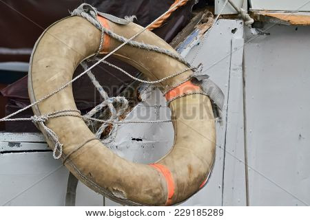 Closeup Of A Lifebuoy Hanging On A Big Fishing Boat