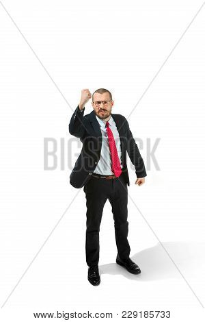 Angry Aggressive Businessman Threatening By Fist To Camera. Isolated On White Studio Background. Ser