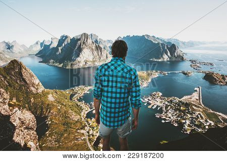 Traveler Man Standing On Cliff Edge Alone Traveling In Norway Lifestyle Adventure Outdoor Summer Vac
