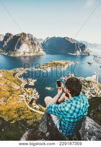 Man Tourist Taking Selfie By Smartphone On Cliff Travel Lifestyle Concept Adventure Outdoor In Norwa