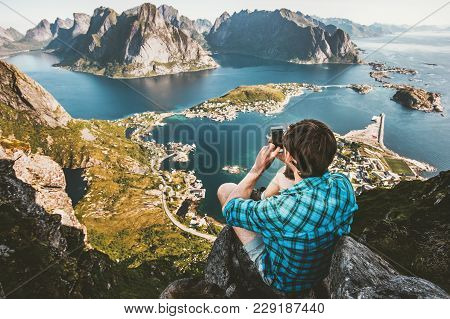 Man Traveler Taking Photo By Smartphone Traveling In Norway Lifestyle Concept Adventure Outdoor Sitt